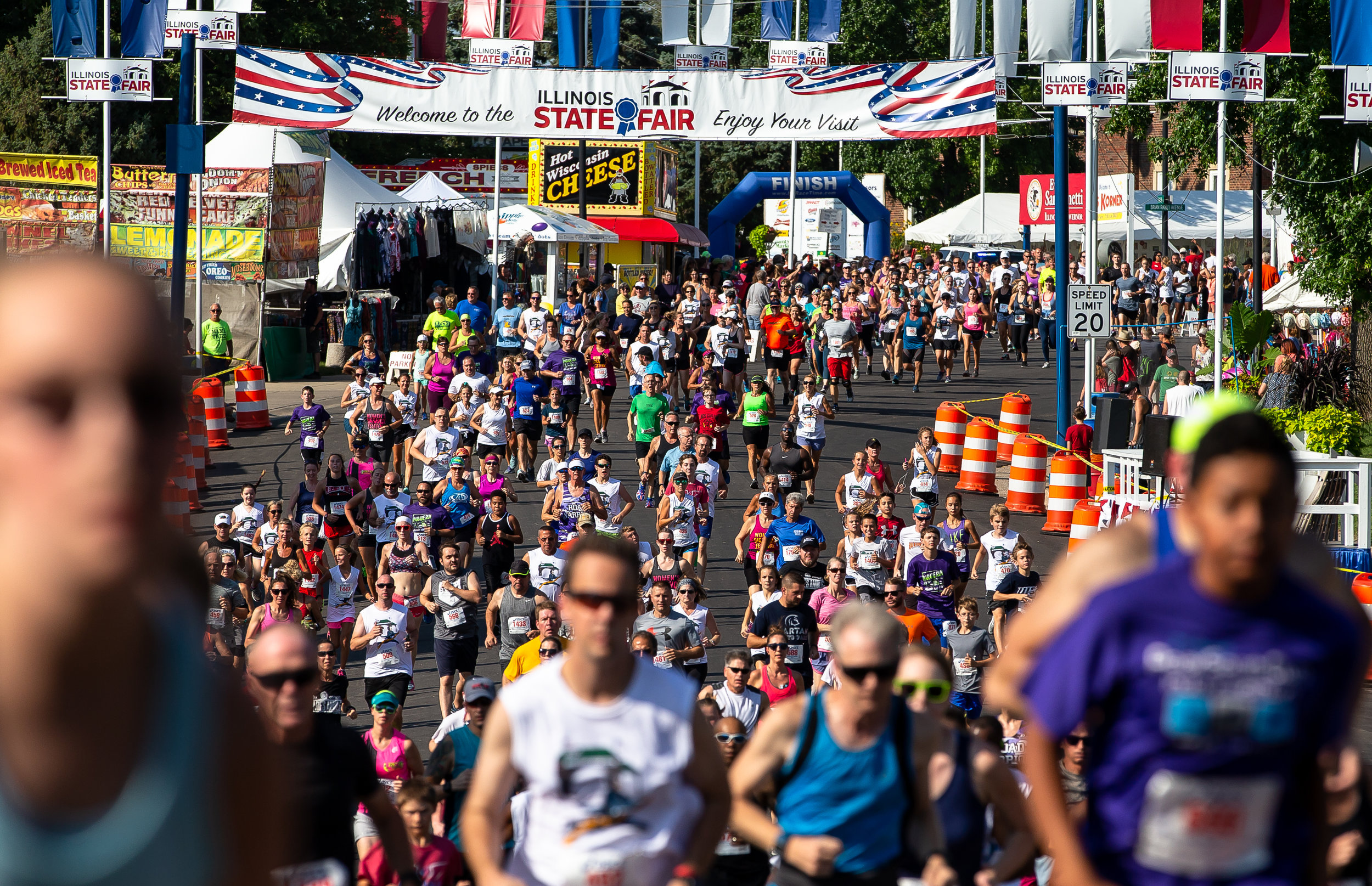 Runners fill Main Street as they set out for the Illinois State Fair Parade Run prior to the Illinois State Fair Twilight Parade, Thursday, Aug. 9, 2018, in Springfield, Ill. [Justin L. Fowler/The State Journal-Register]