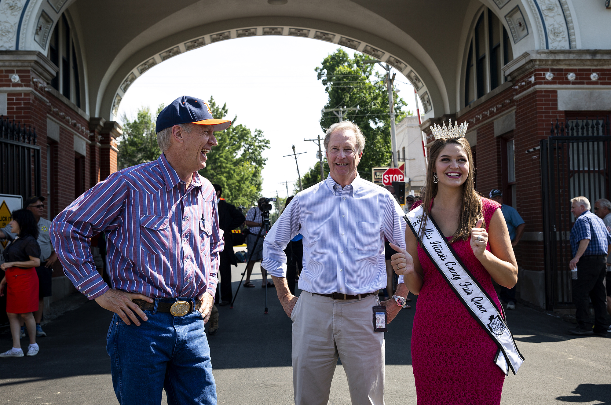 Gov. Bruce Rauner, talks with Jeff Heck from the Illinois Capital Development Board and Samantha Hasselbring, Miss Illinois County Fair Queen, after cutting the ribbon to officially open the 2018 Illinois State Fair Thursday, Aug. 9, 2018 on the Illinois State Fairgrounds in Springfield, Ill. [Rich Saal/The State Journal-Register]