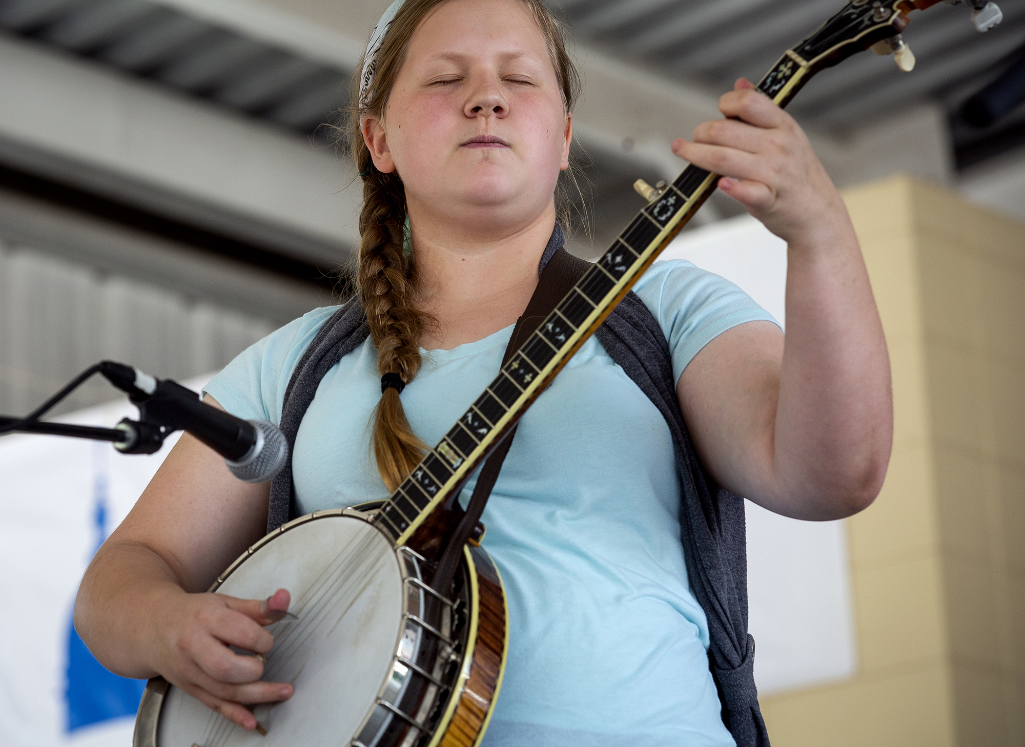 Joy Worthington concentrates on the music while playing Foggy Mountain Breakdown during the Fiddle and Banjo contest on the Lincoln Stage at the Illinois State Fair Saturday, Aug. 11, 2018 on the fairgrounds in Springfield, Ill. [Rich Saal/The State Journal-Register]