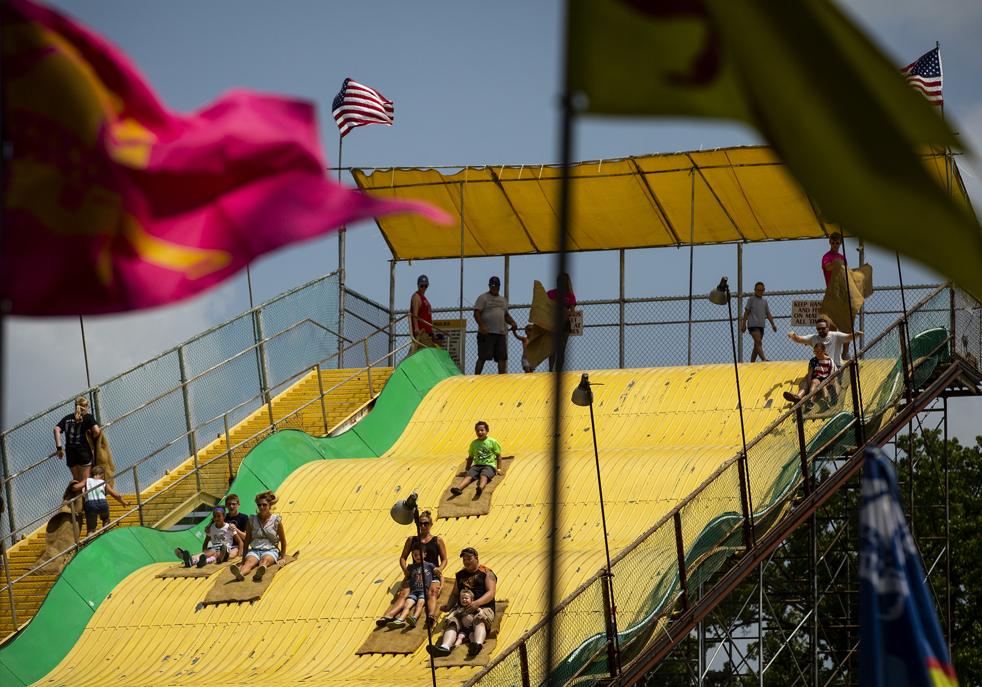 People descend the Giant Slide at the Illinois State Fair Saturday, Aug. 11, 2018 on the fairgrounds in Springfield, Ill. [Rich Saal/The State Journal-Register]