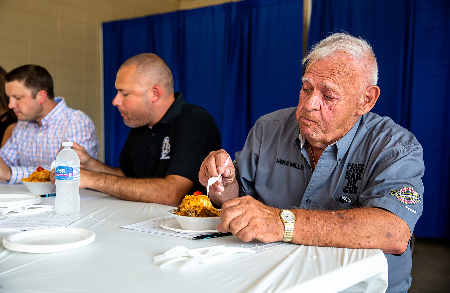 Judge Mike Mills, of 17th Street BBQ, is impressed by the hot beef sundae from Ken Haarstad with Classic Kitchen out of Austin, Minn., while judging the savory category for the Golden Abe's Fantastic Fair Food competition at the Lincoln Stage on the Illinois State Fairgrounds, Friday, Aug. 10, 2018, in Springfield, Ill. [Justin L. Fowler/The State Journal-Register]