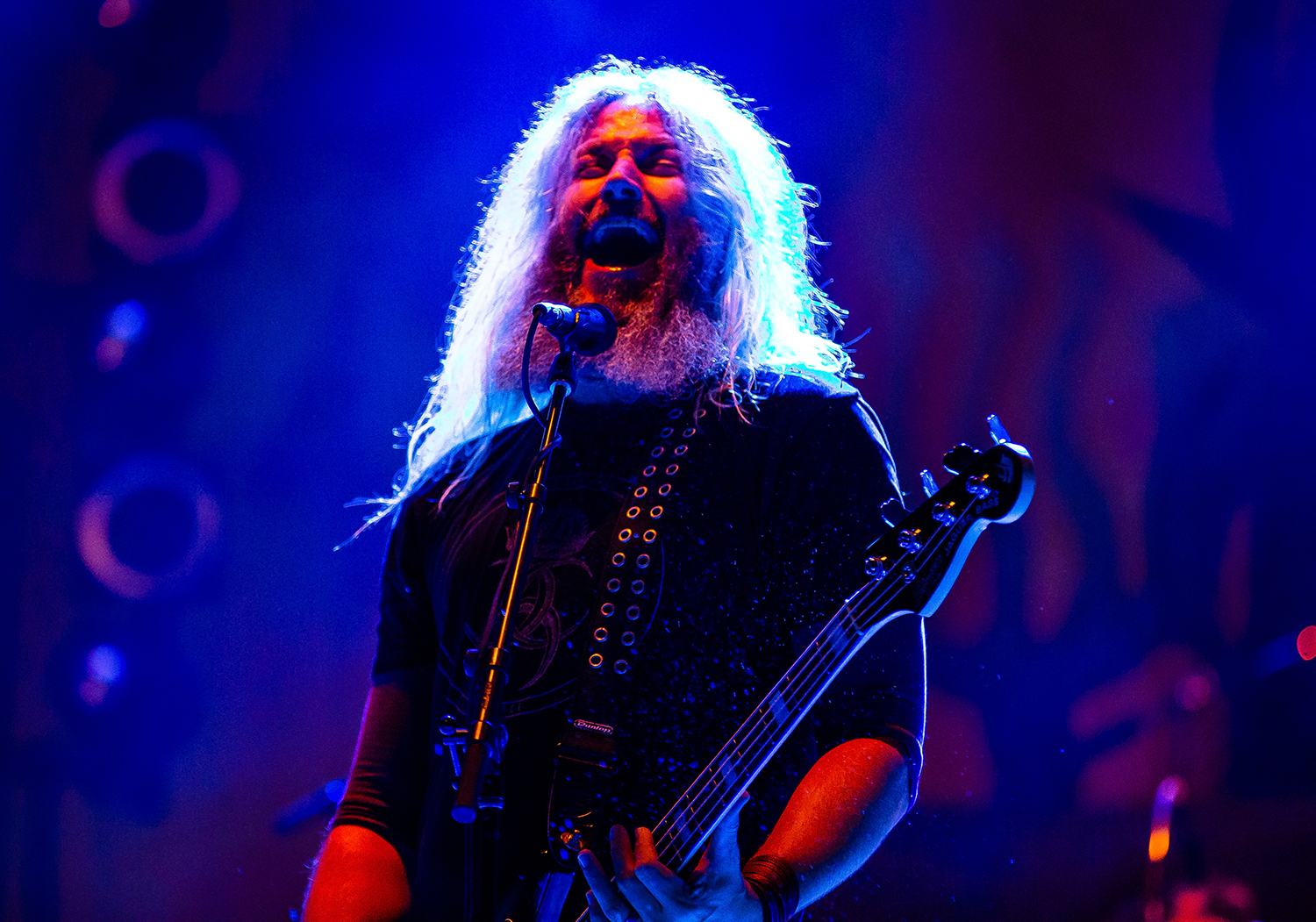 Troy Sanders on the bass guitar with Mastodon as the band performs on the Grandstand Stage during the Illinois State Fair, Saturday, Aug. 11, 2018, in Springfield, Ill. [Justin L. Fowler/The State Journal-Register]
