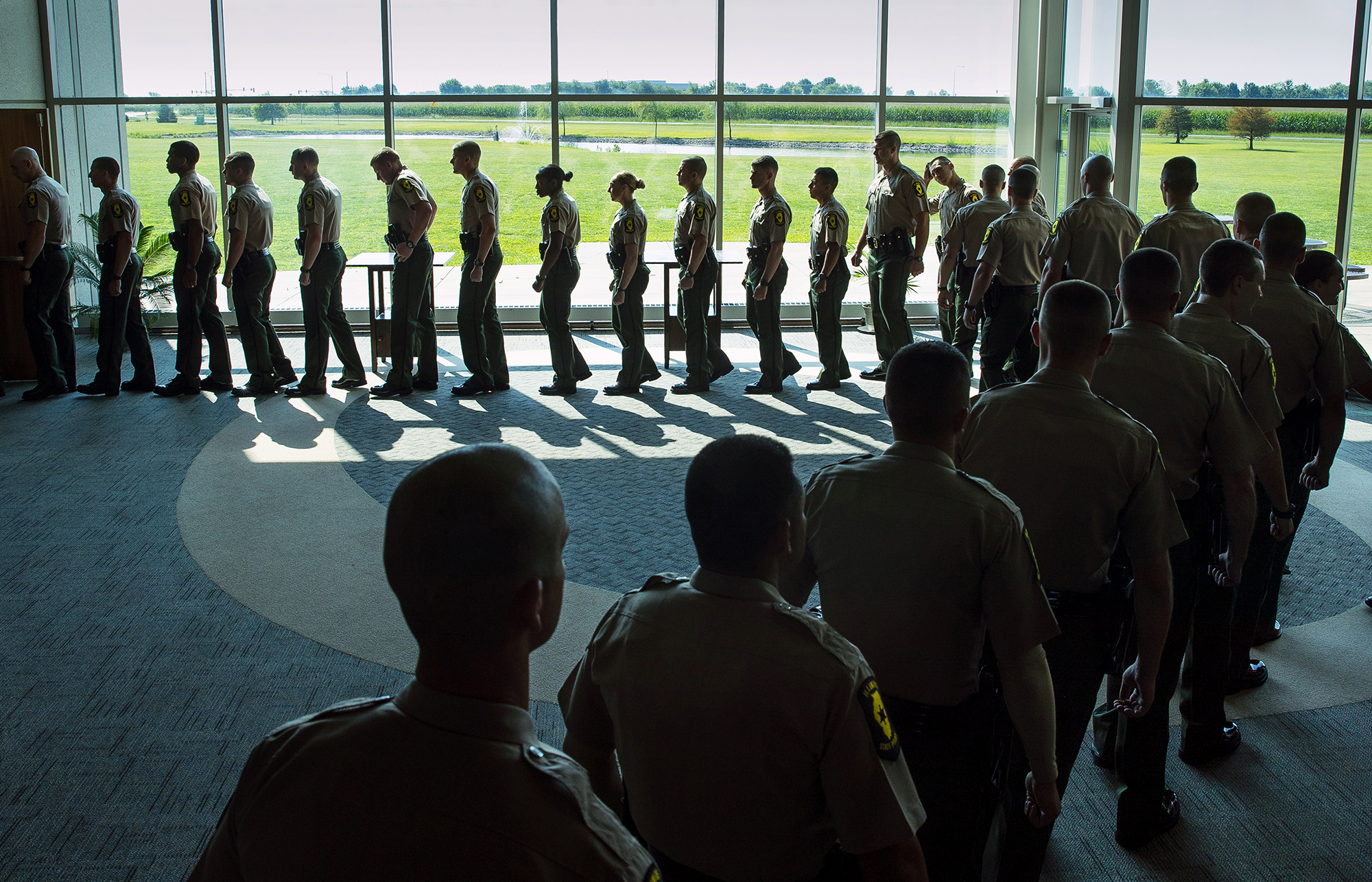 Cadets wait to file into the sanctuary during the Illinois State Police Cadet Class 127 Graduation at Hope Church Friday, Aug. 10, 2018. Eighty-one cadets graduated. [Ted Schurter/The State Journal-Register]