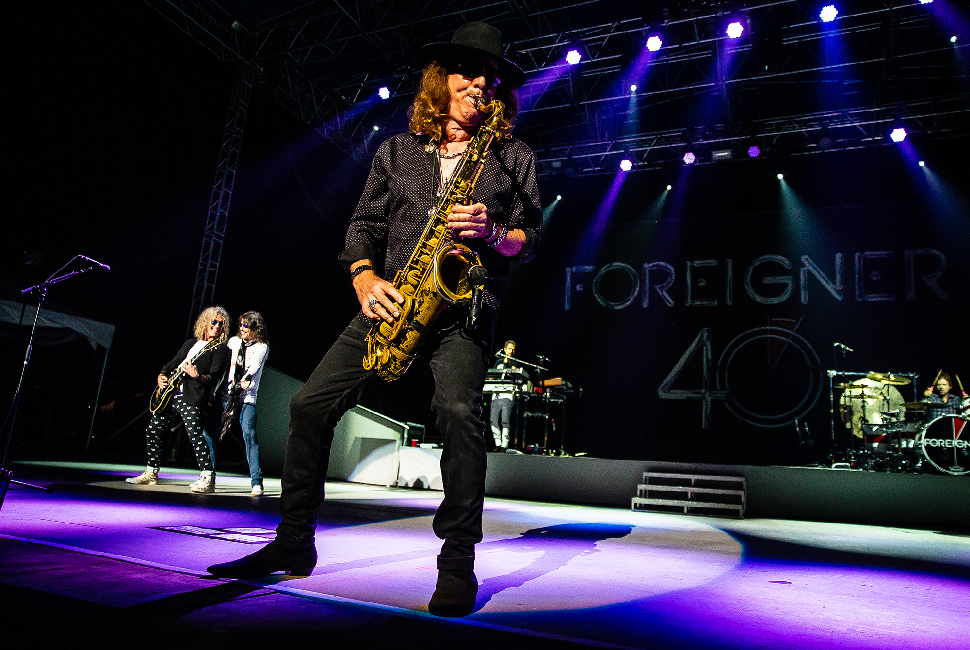 Tom Gimbel on the saxophone with Foreigner as the band  performs on the Grandstand Stage during the Illinois State Fair at the Illinois State Fairgrounds, Sunday, Aug. 12, 2018, in Springfield, Ill. [Justin L. Fowler/The State Journal-Register]