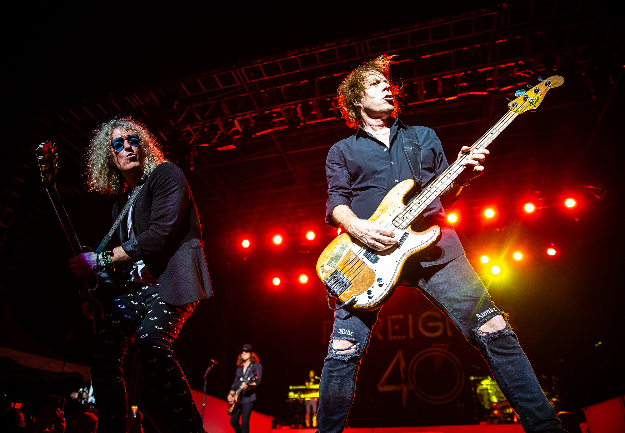 Guitarist Bruce Watson, left, and bassist Jeff Pilson, right, perform with Foreigner as the band performs on the Grandstand Stage during the Illinois State Fair at the Illinois State Fairgrounds, Sunday, Aug. 12, 2018, in Springfield, Ill. [Justin L. Fowler/The State Journal-Register]