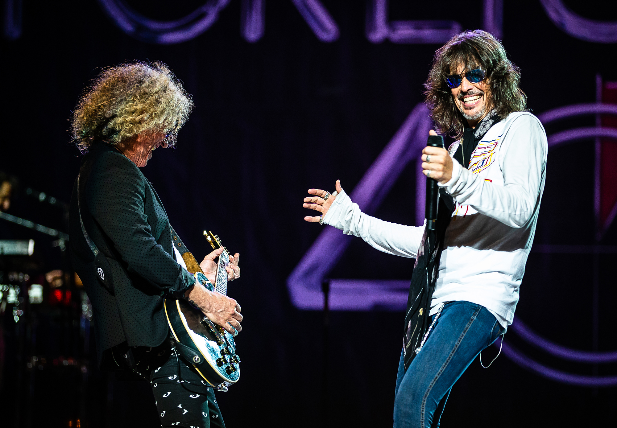 Lead singer Kelly Hansen, right, performs with guitarist Bruce Watson, left, with Foreigner as the band performs on the Grandstand Stage during the Illinois State Fair at the Illinois State Fairgrounds, Sunday, Aug. 12, 2018, in Springfield, Ill. [Justin L. Fowler/The State Journal-Register]