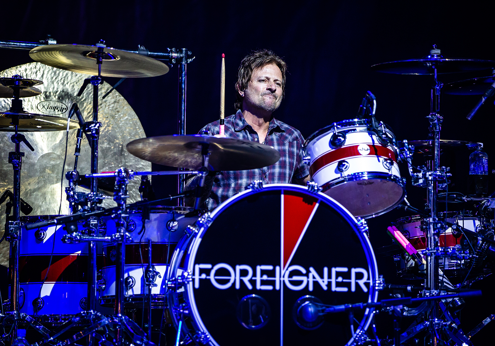 Chris Frazier on the drums with Foreigner as the band performs on the Grandstand Stage during the Illinois State Fair at the Illinois State Fairgrounds, Sunday, Aug. 12, 2018, in Springfield, Ill. [Justin L. Fowler/The State Journal-Register]