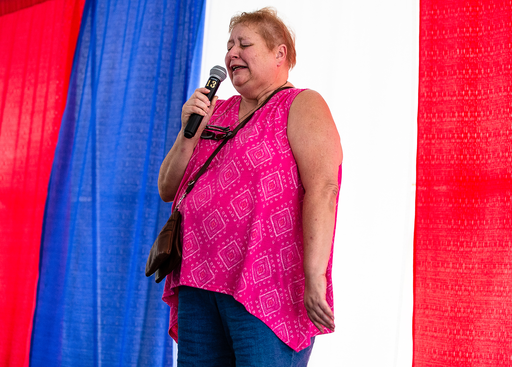 Shelly Flickinger gives her best performance to call in her husband to win the Husband Calling Contest during the Husband and Hog Calling contest inside the Ag Tent at the Illinois State Fairgrounds, Sunday, Aug. 12, 2018, in Springfield, Ill. [Justin L. Fowler/The State Journal-Register]