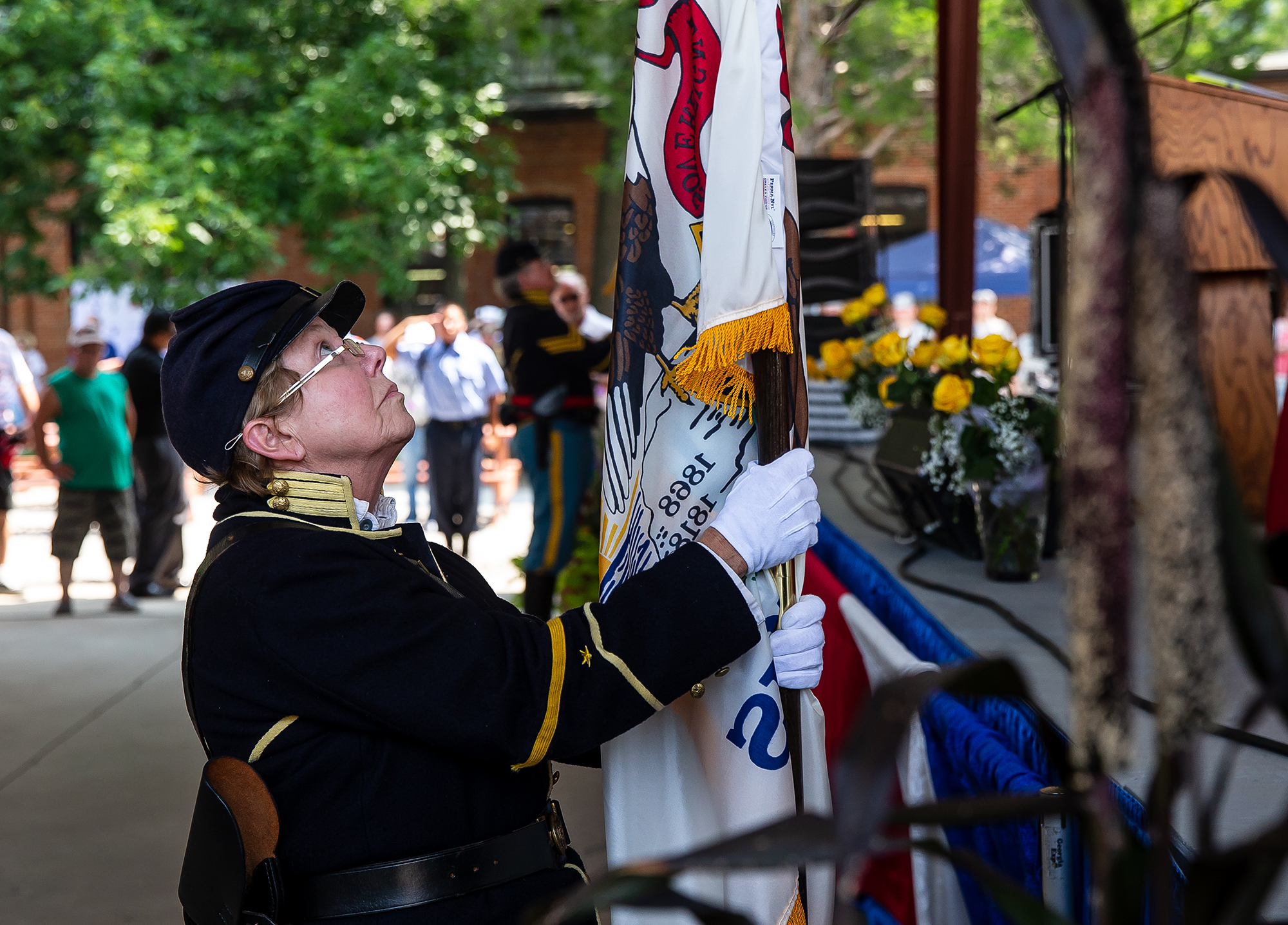 Marti Schneerman with the 10th Illinois Volunteer Calvary Regiment places the Illinois Flag during the Posting of the Colors during the Veterans Day program at the Illinois State Fair on the Lincoln Stage at the Illinois State Fairgrounds, Sunday, Aug. 12, 2018, in Springfield, Ill. [Justin L. Fowler/The State Journal-Register]