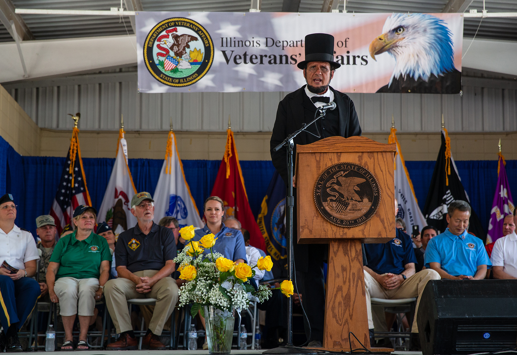Abraham Lincoln, portrayed by George Buss, gives a narrative of the 200 years of Illinois military history as part of a presentation done by Looking For Lincoln and the Living History Detachment Reenactors during Veterans Day at the Illinois State Fair on the Lincoln Stage at the Illinois State Fairgrounds, Sunday, Aug. 12, 2018, in Springfield, Ill. [Justin L. Fowler/The State Journal-Register]