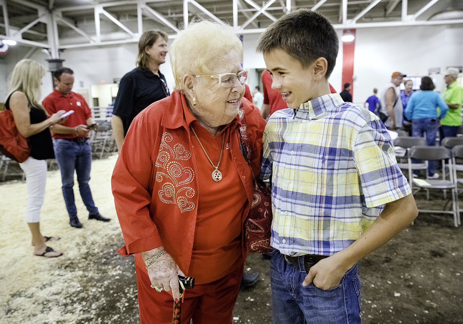 Evelyn Brandt Thomas, founder of Brandt Consolidated, congratulates Adam Miller after his Grand Champion Steer sold for $60,000 at the Governor's Sale of Champions in the Livestock Center at the Illinois State Fair Tuesday, Aug. 14, 2018. [Ted Schurter/The State Journal-Register]