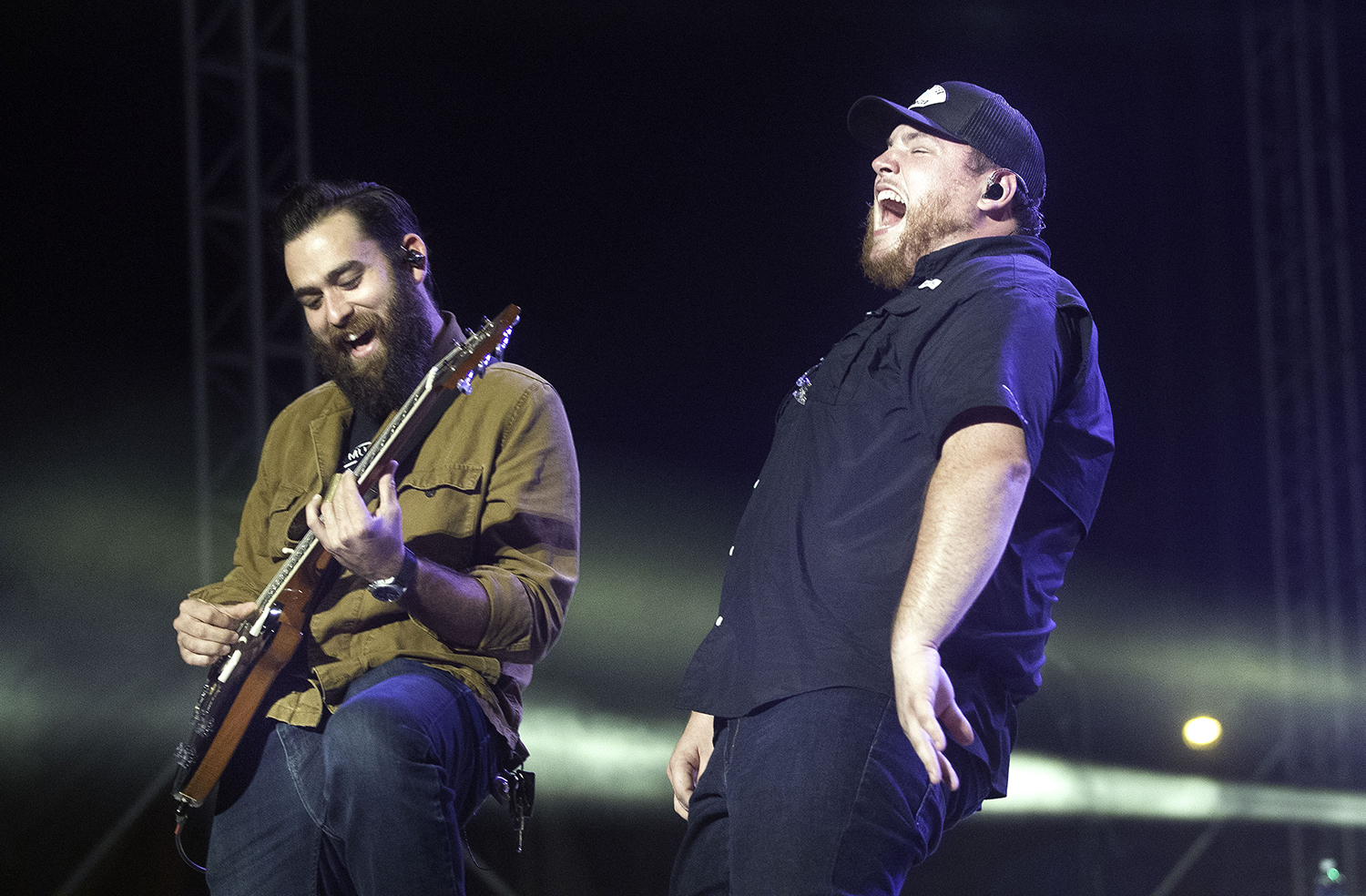 Country artist Luke Combs, right, lets out a roar as he performs at the Grandstand during the Illinois State Fair Tuesday, Aug. 14, 2018. [Ted Schurter/The State Journal-Register]