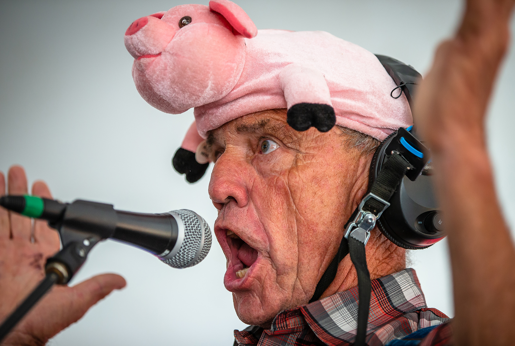 "Chris Karr, of Seymour, Ill., uses his ""Ham Radio"" to call in a hog while competing during the Husband and Hog Calling contest inside the Ag Tent at the Illinois State Fairgrounds, Sunday, Aug. 12, 2018, in Springfield, Ill. Karr finished second in the competition to Andrew Metheney, of Georgetown, Ill., won the contest for the third year in a row. Shelly Flickinger won the Husband Calling Contest and Cody Covalesky, of Greenville, Ill., won the first ever Duck Calling Contest.  [Justin L. Fowler/The State Journal-Register]"