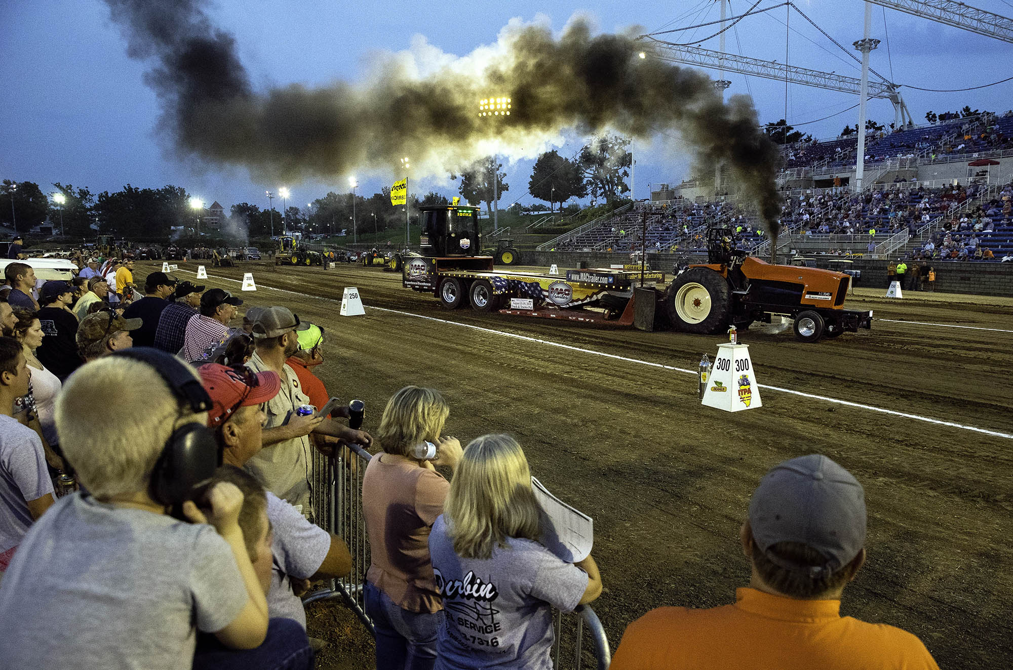 Tony Isbell of Marion, Ill., drives Empty Pockets down the track during the 9500 Pro Farm class of the 2018 Illinois State Fair Tractor Pull at the Rodeo Arena Monday, Aug. 13, 2018. The truck and tractor pull continue through Wednesday. [Ted Schurter/The State Journal-Register]