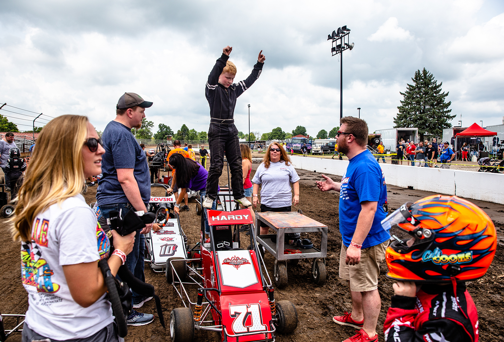 Gage Hardy, of Decatur, Ill., pretends to celebrate winning after he climbs out of his quarter midget after the group of young drivers took a parade lap around the track prior to the USAC Silver Crown Bettenhausen 100 on the Springfield Mile during the Illinois State Fair at the Illinois State Fairgrounds, Saturday, Aug. 18, 2018, in Springfield, Ill. [Justin L. Fowler/The State Journal-Register]