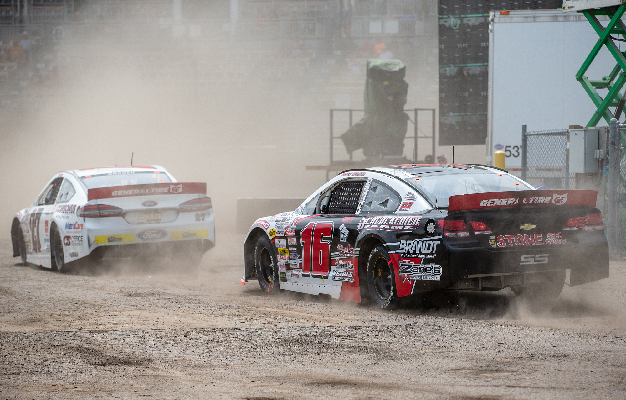 Kelly Kovski heads out of the pits in a cloud of dust in a caution during the ARCA Racing Series Allen Crowe 100 on the Springfield Mile during the Illinois State Fair at the Illinois State Fairgrounds, Sunday, Aug. 19, 2018, in Springfield, Ill. [Justin L. Fowler/The State Journal-Register]