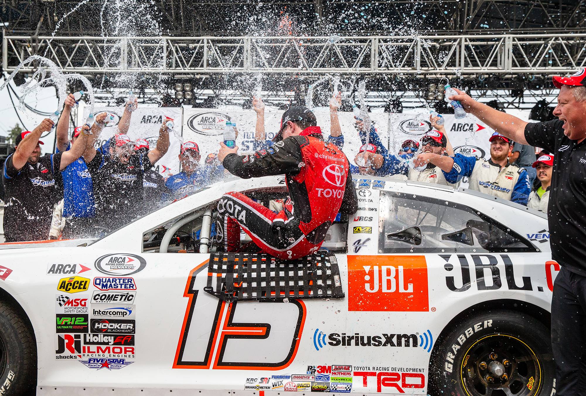 Christian Eckes is doused with water by his crew after climbing out of his car the winner of the ARCA Racing Series Allen Crowe 100 on the Springfield Mile during the Illinois State Fair at the Illinois State Fairgrounds, Sunday, Aug. 19, 2018, in Springfield, Ill. [Justin L. Fowler/The State Journal-Register]