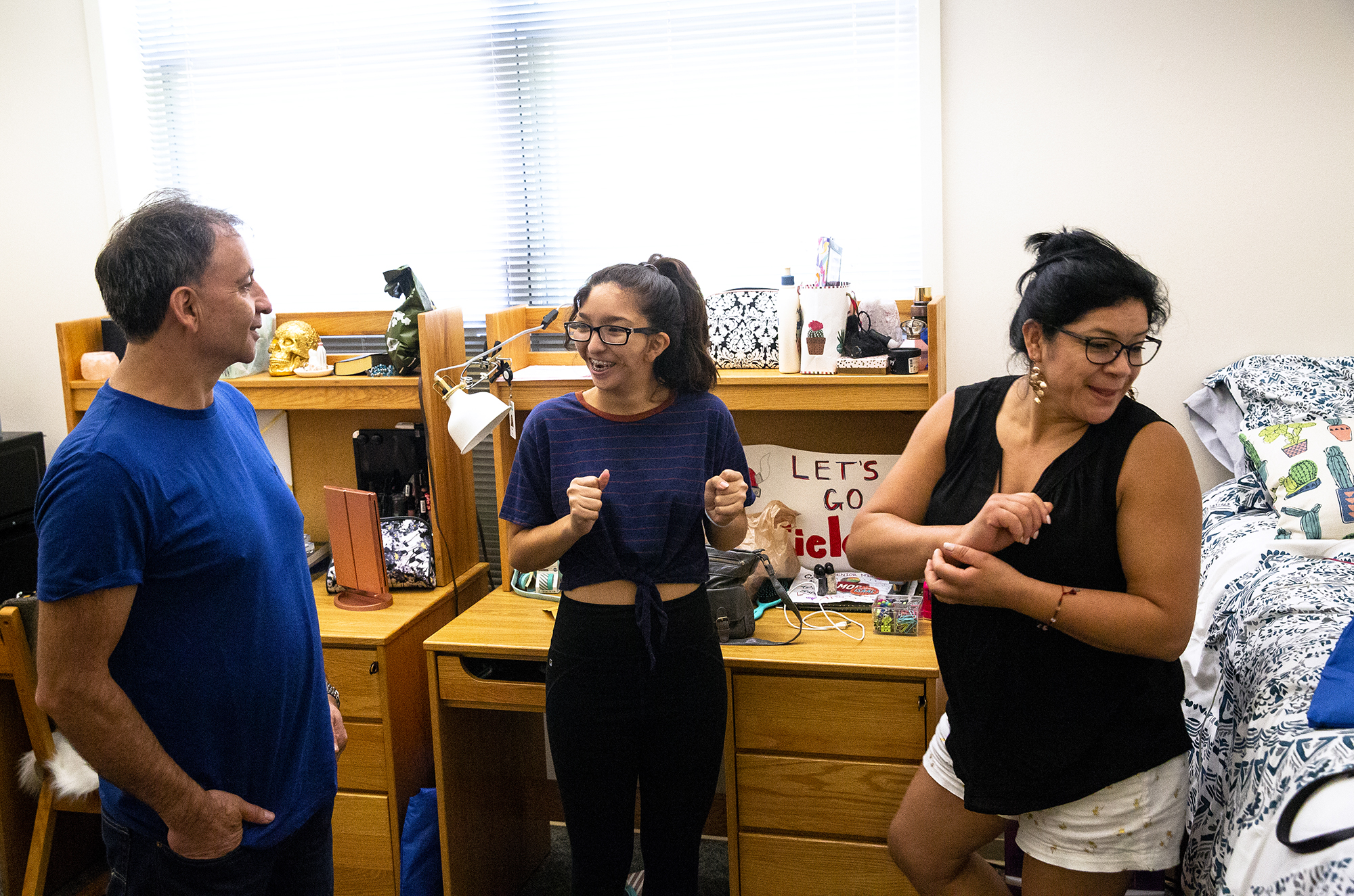 """I think I'm ready. I'm excited,"" says Cielo Delgado about her freshman year of college. Delgado, who is from Chicago, moved into her room in Lincoln Residence Hall at the University of Illinois Springfield Wednesday, Aug. 22, 2018 with help from her parents, Juan and Edith, and her sister Marisol. According to the university, approximately 300 freshman arrived for the official move-in, with upperclassmen arriving Friday. [Rich Saal/The State Journal-Register]"