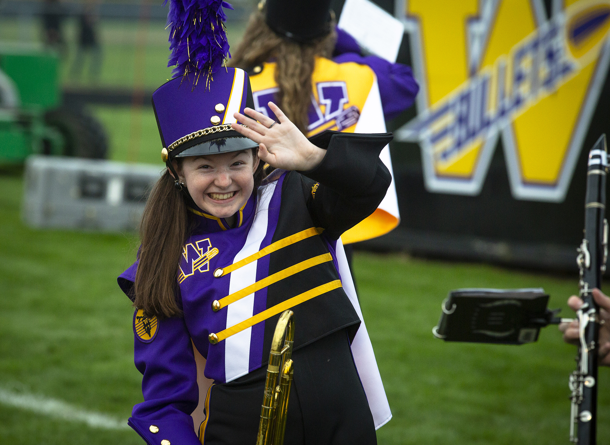 Addison Lopian waves to her grandfather, Jeff Lopian, before she takes the field with the Williamsville High School band Friday, Aug. 24, 2018 at Williamsville High School in Williamsville, Ill. [Rich Saal/The State Journal-Register]