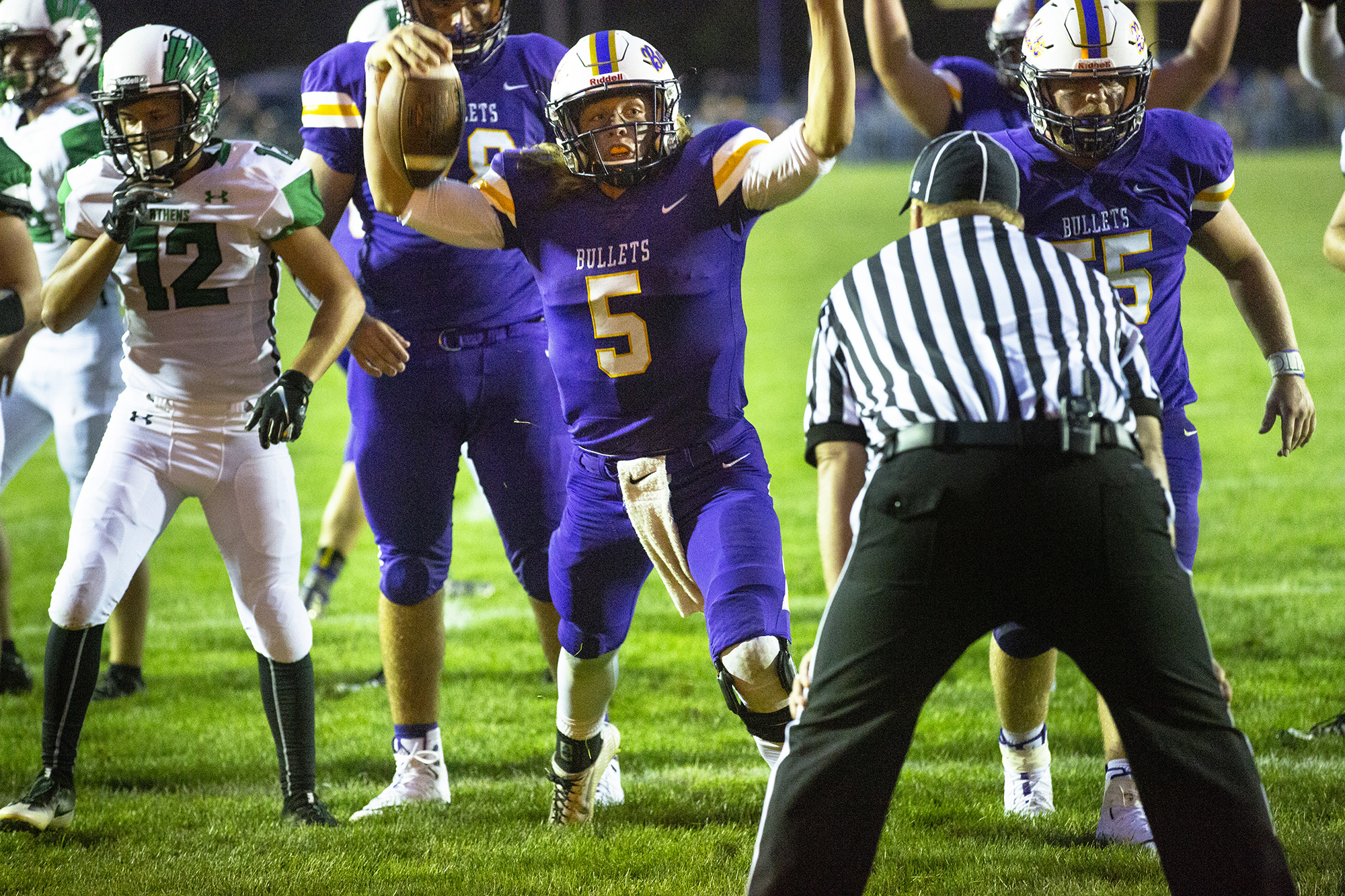 Williamsville's Damon Coady signals touchdown on a quarterback keep to put the Bullets up 14-8 over Athens in the first half Friday, Aug. 24, 2018 at Williamsville High School in Williamsville, Ill. [Rich Saal/The State Journal-Register]