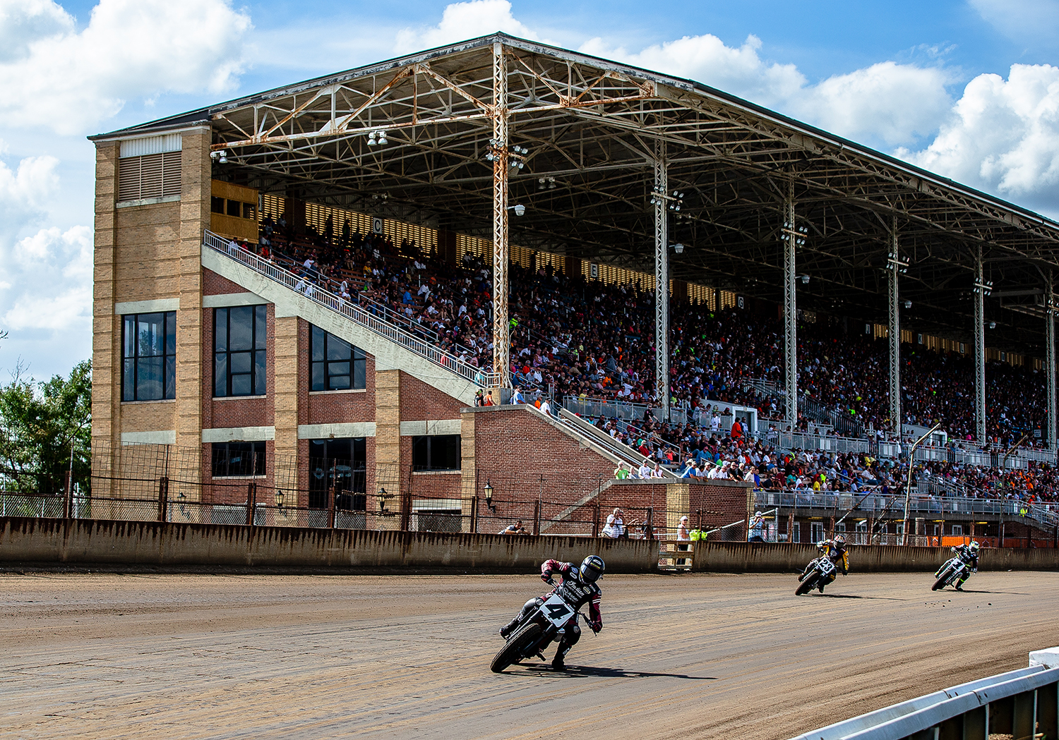 Bryan Smith leads the field into turn one on his Indian Scout FTR750 during the American Flat Track Springfield Mile II at the Illinois State Fairgrounds, Sunday, Sept. 2, 2018, in Springfield, Ill. [Justin L. Fowler/The State Journal-Register]