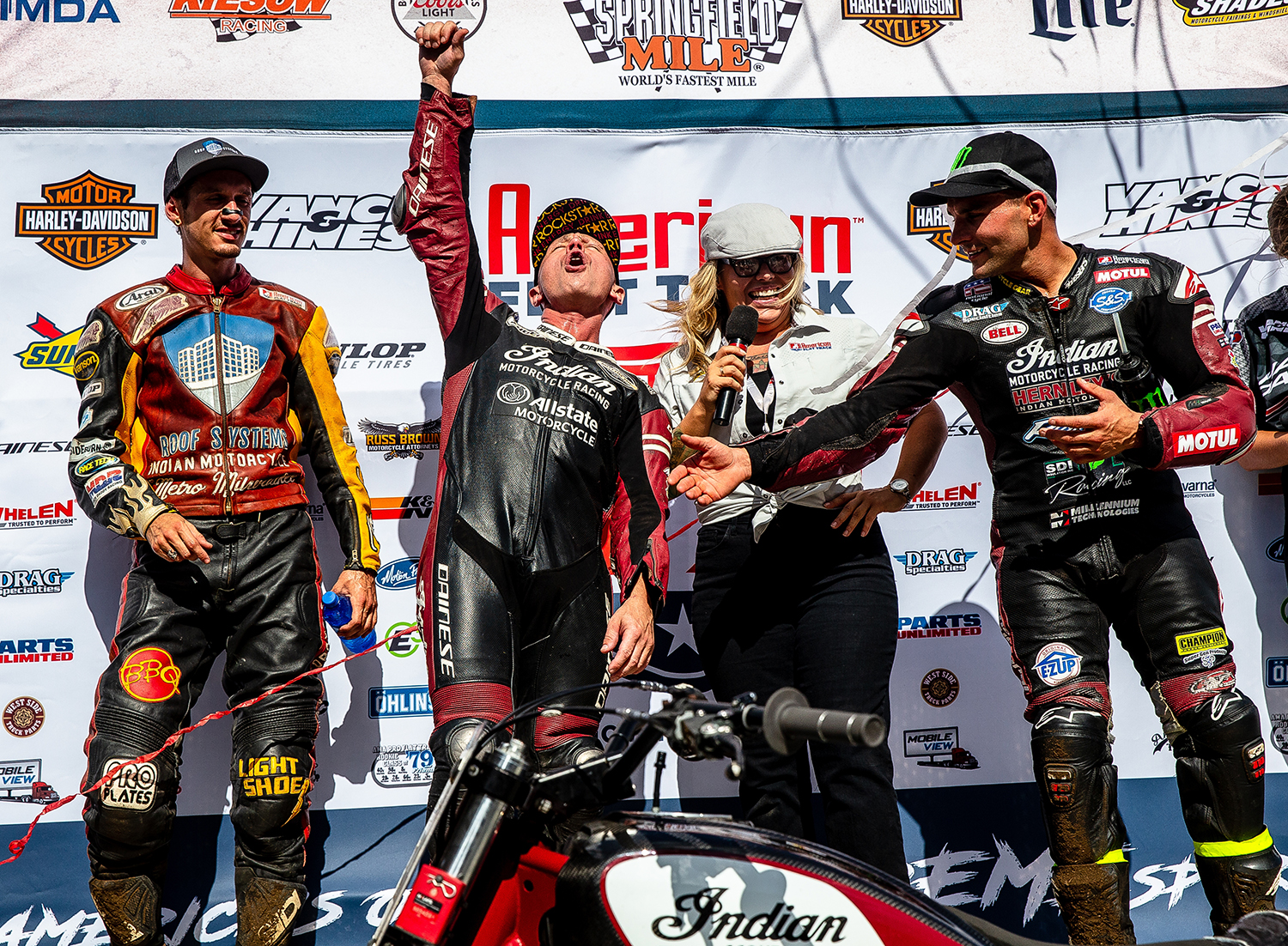 Bryan Smith screams out as he takes the top spot on the podium to celebrate winning his ninth race on the Springfield Mile during the American Flat Track Springfield Mile II at the Illinois State Fairgrounds, Sunday, Sept. 2, 2018, in Springfield, Ill. [Justin L. Fowler/The State Journal-Register]