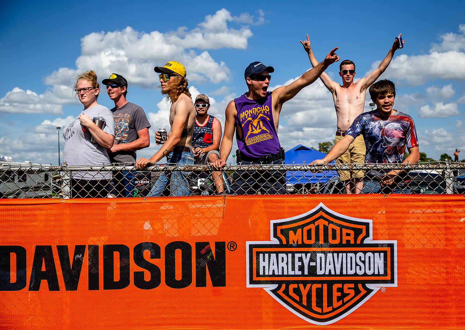 Fans cheer on the racers as they go through turn one during the American Flat Track Springfield Mile II at the Illinois State Fairgrounds, Sunday, Sept. 2, 2018, in Springfield, Ill. [Justin L. Fowler/The State Journal-Register]