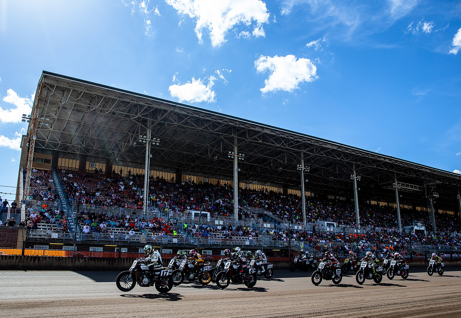 Henry Wiles carries his front tire through the start on his Indian Scout FTR750 as he leads the pack towards turn one on the opening lap of the American Flat Track Springfield Mile II at the Illinois State Fairgrounds, Sunday, Sept. 2, 2018, in Springfield, Ill. [Justin L. Fowler/The State Journal-Register]