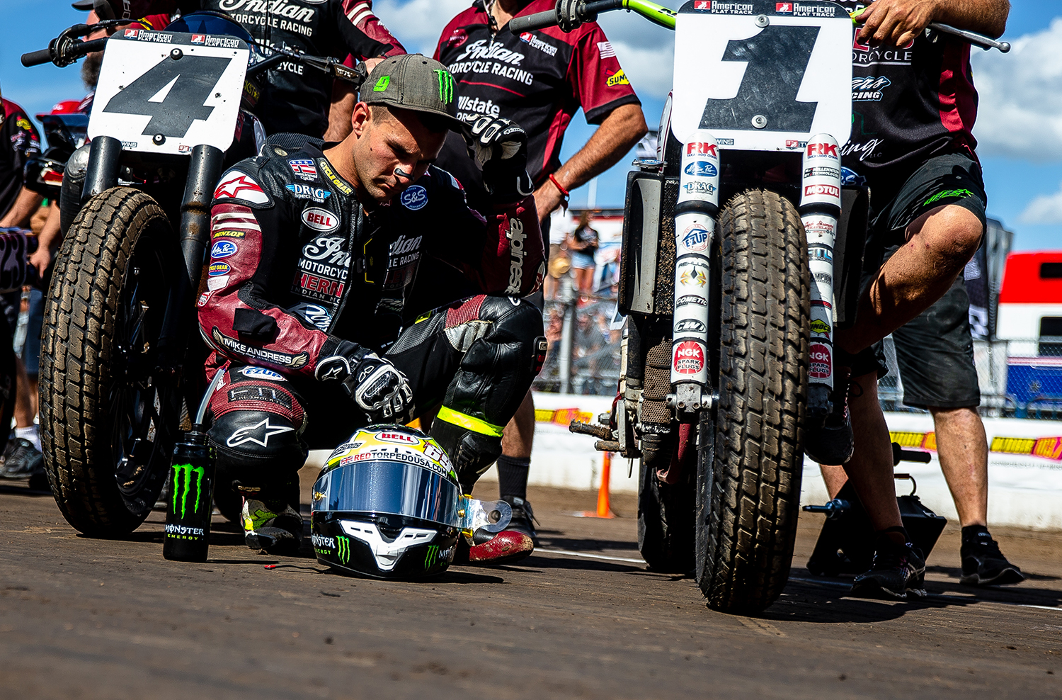 Jared Mees crouches next to his Indian Scout FTR750 as he waits for the driver introductions during the American Flat Track Springfield Mile II at the Illinois State Fairgrounds, Sunday, Sept. 2, 2018, in Springfield, Ill. [Justin L. Fowler/The State Journal-Register]