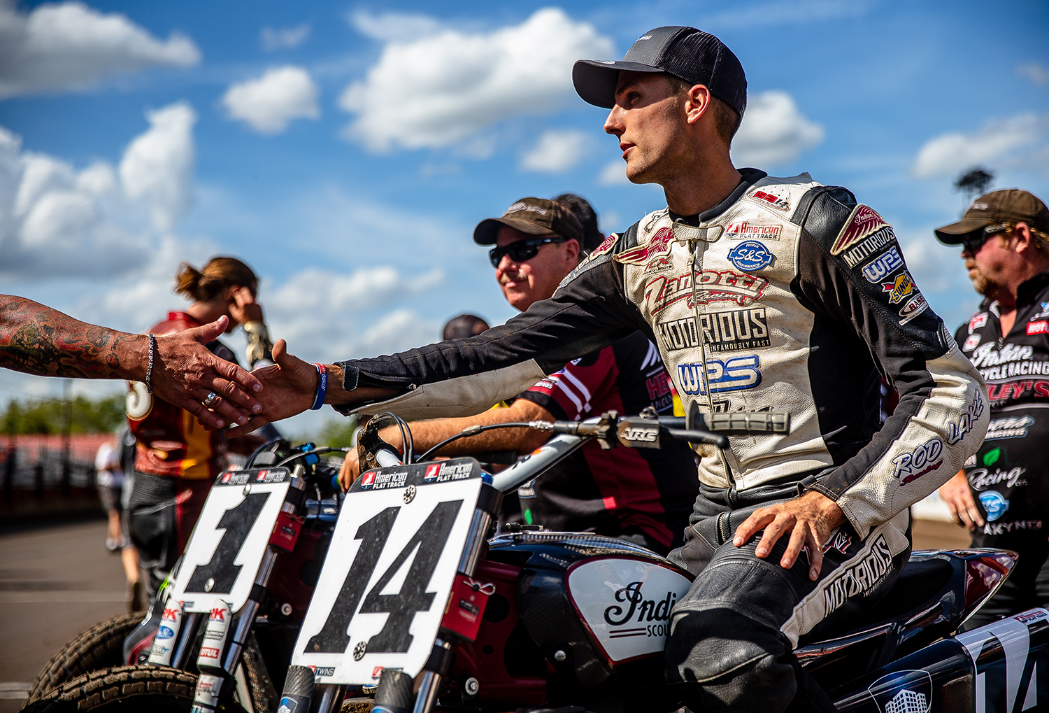 Briar Bauman shakes hands as waits atop his Indian Scout FTR750 for the start of the American Flat Track Springfield Mile II at the Illinois State Fairgrounds, Sunday, Sept. 2, 2018, in Springfield, Ill. [Justin L. Fowler/The State Journal-Register]