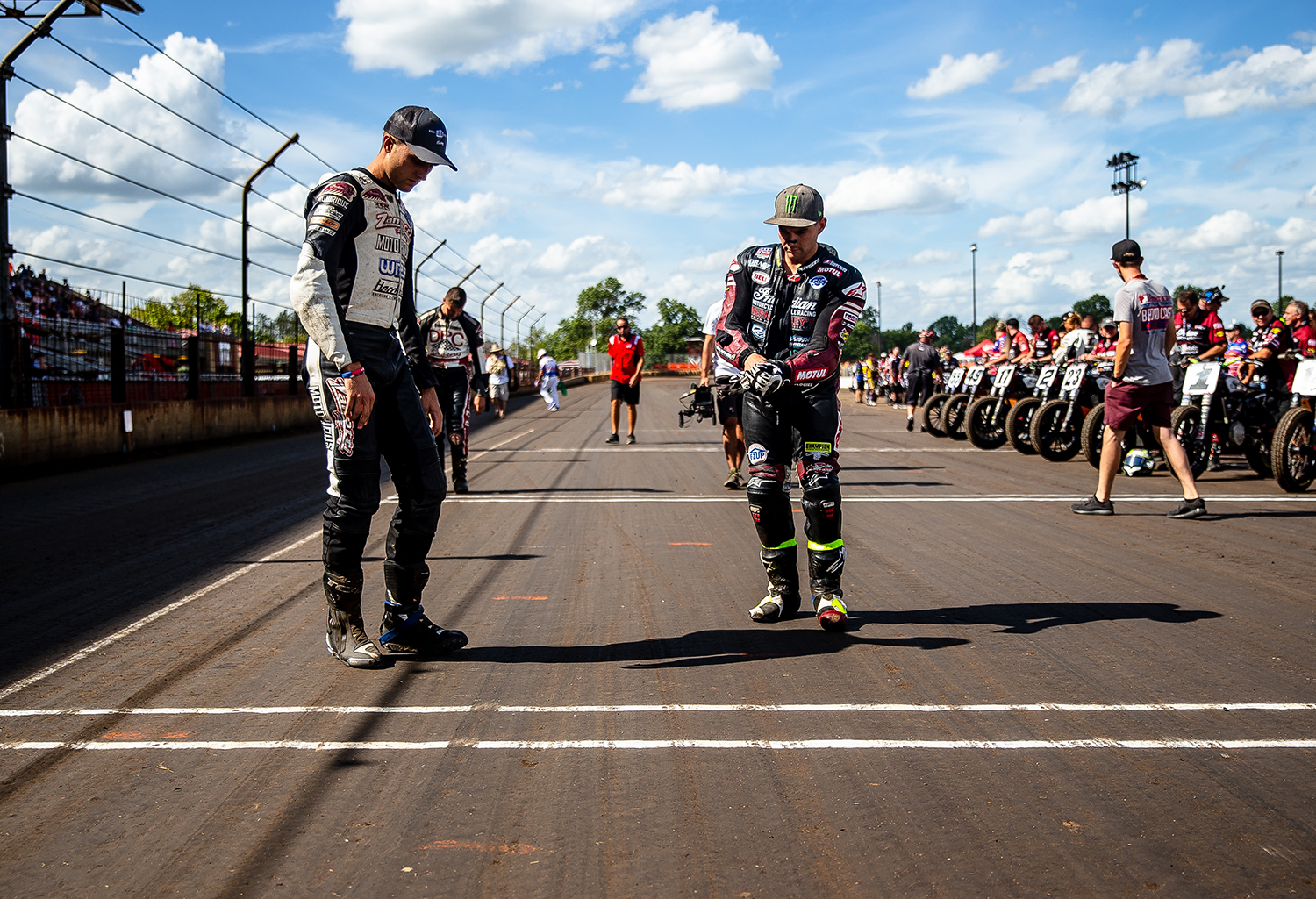 Briar Bauman, left, and Jared Mees, center, check out track conditions before picking out where they want to start for the American Flat Track Springfield Mile II at the Illinois State Fairgrounds, Sunday, Sept. 2, 2018, in Springfield, Ill. [Justin L. Fowler/The State Journal-Register]