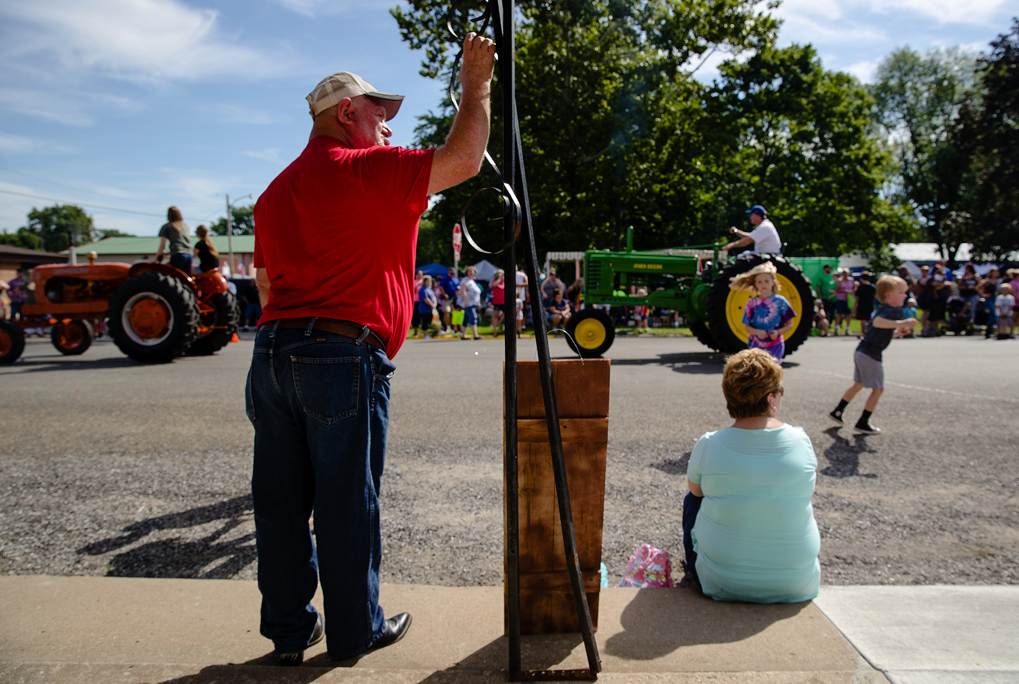 Russell Dennis watchs the antique tractors go by during the 50th Annual Greenview Labor Day Celebration Monday, Sept. 3, 2018. [Ted Schurter/The State Journal-Register]