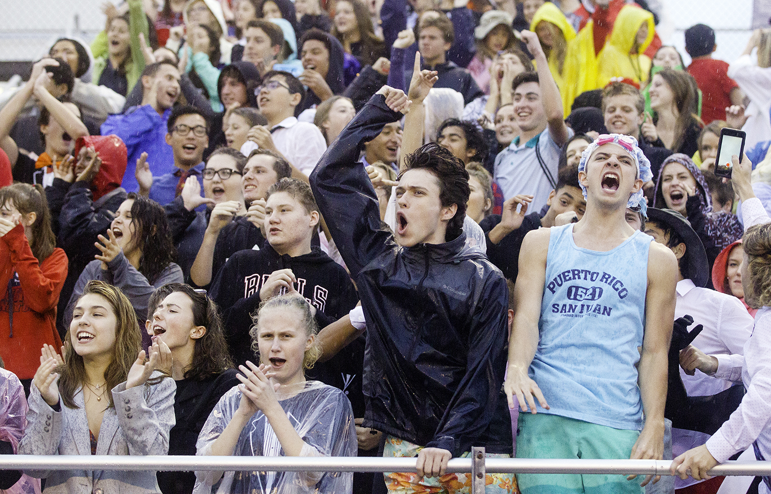 Springfield fans cheer as the Senators take the field against Glenwood in a light right at Memorial Stadium Friday, Sept. 7, 2018. [Ted Schurter/The State Journal-Register]