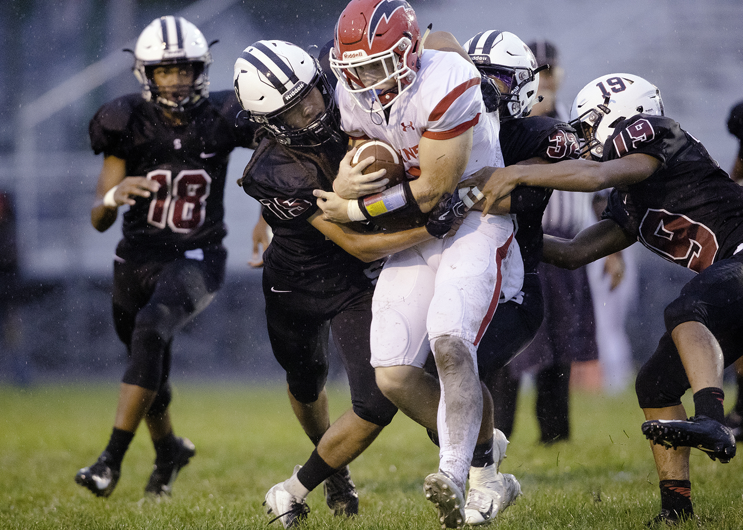 Springfield defenders tackle Glenwood's Austin Schiff at Memorial Stadium Friday, Sept. 7, 2018. [Ted Schurter/The State Journal-Register]