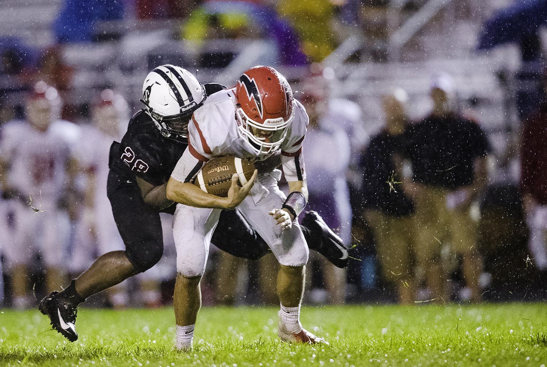 Springfield's Jerone Justin sacks Glenwood's Luke Lehnen at Memorial Stadium Friday, Sept. 7, 2018. [Ted Schurter/The State Journal-Register]