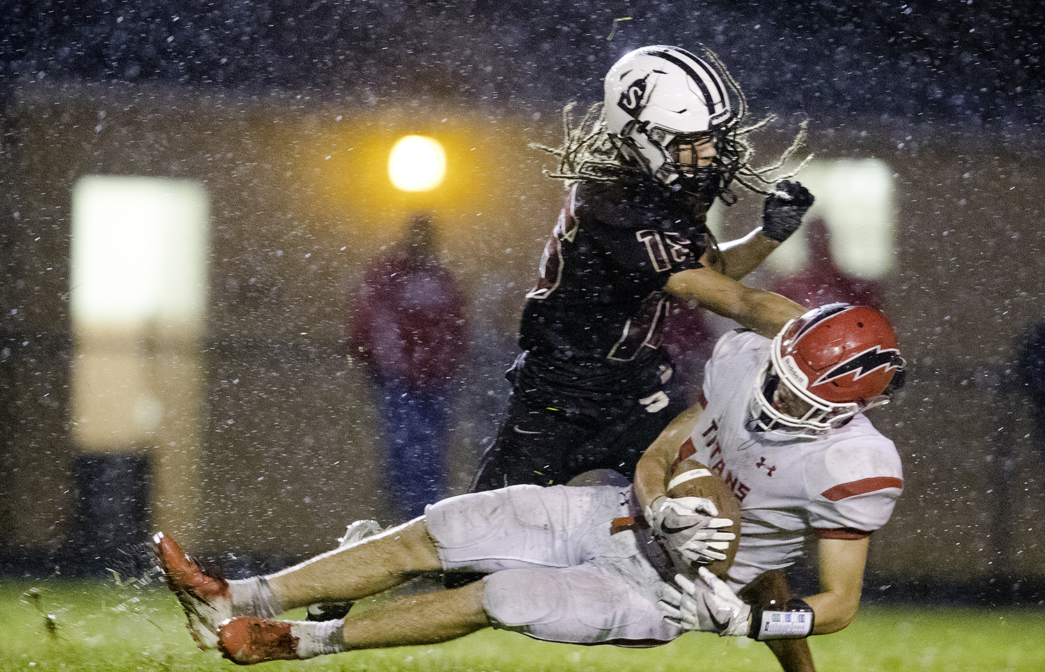 Springfield's Xavier Cooper knocks Glenwood's Tyler Burris to the ground after he made a reception in the first half at Memorial Stadium Friday, Sept. 7, 2018. [Ted Schurter/The State Journal-Register]