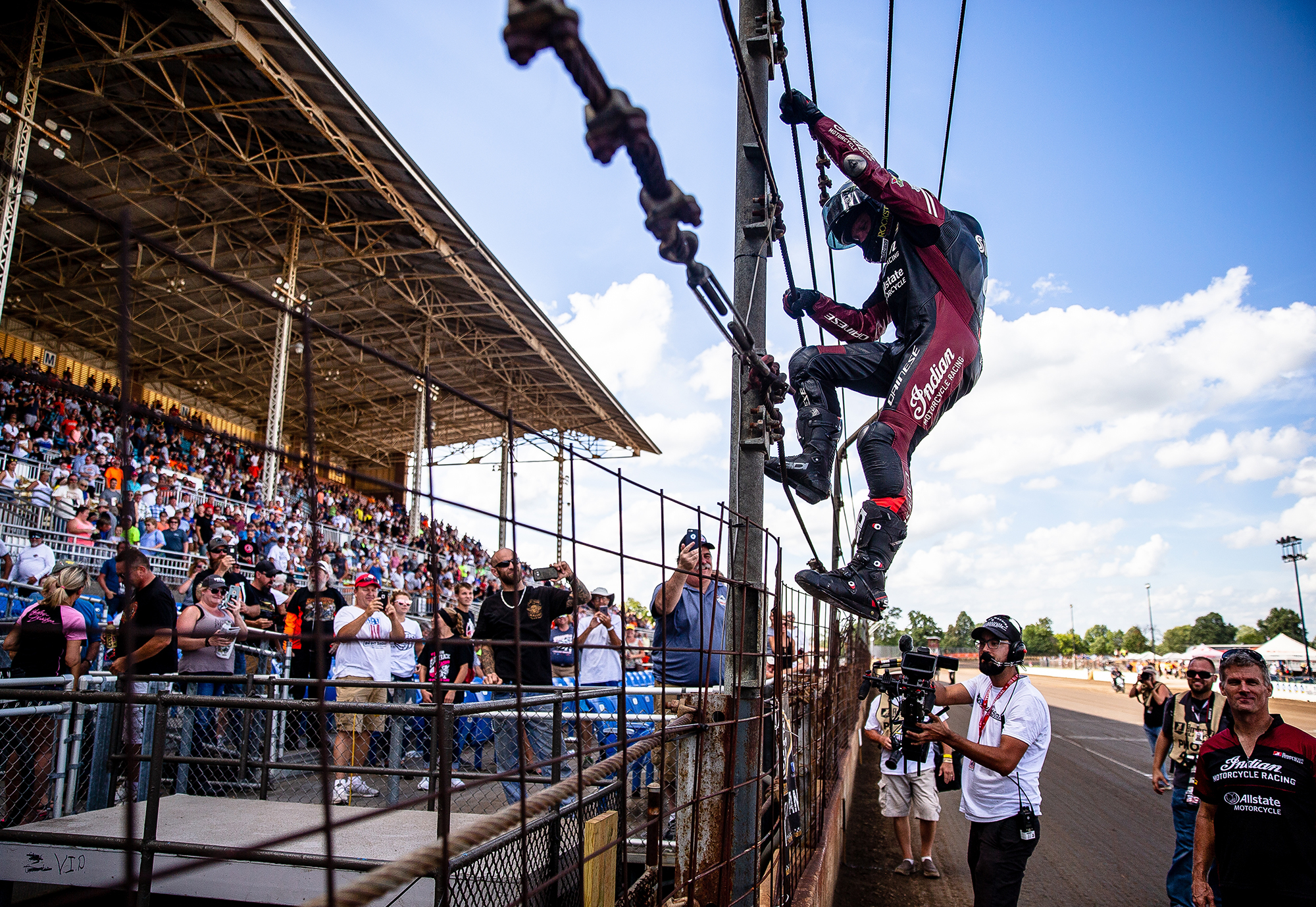 Bryan Smith climbs the fence to celebrate his ninth win on the Springfield Mile during the American Flat Track Springfield Mile II at the Illinois State Fairgrounds, Sunday, Sept. 2, 2018, in Springfield, Ill. [Justin L. Fowler/The State Journal-Register]
