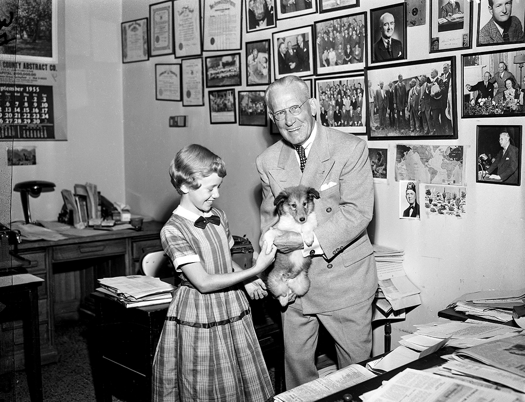 """Illinois State Register editor, V.Y.Dallman, meeting with girl and dog, Sept. 23, 1955. Bonnie Kepner, 11, one of five daughters of Mr. and Mrs. M.W. Kepner, 2052 S. Lincoln, won the """"Why I want a puppy"""" contest sponsored by The State Register and the Senate Theater. V.Y. Dallman, editor of The State Register, is shown presenting the puppy to Bonnie, who named it """"Reggie,"""" after the Register. The contest was held in conjunction with the current showing at the Senate of the famous Richard Harding Davis' story, """"The Bar Sinister,"""" which features the new dog star, """"Wildfire."""" In the stirring movie, Wildfire is the key figure in a romantic comedy starring Jeff Richards and Jarma Lewis. File/The State Journal-RegisterPub. ISR Sept. 1955."""