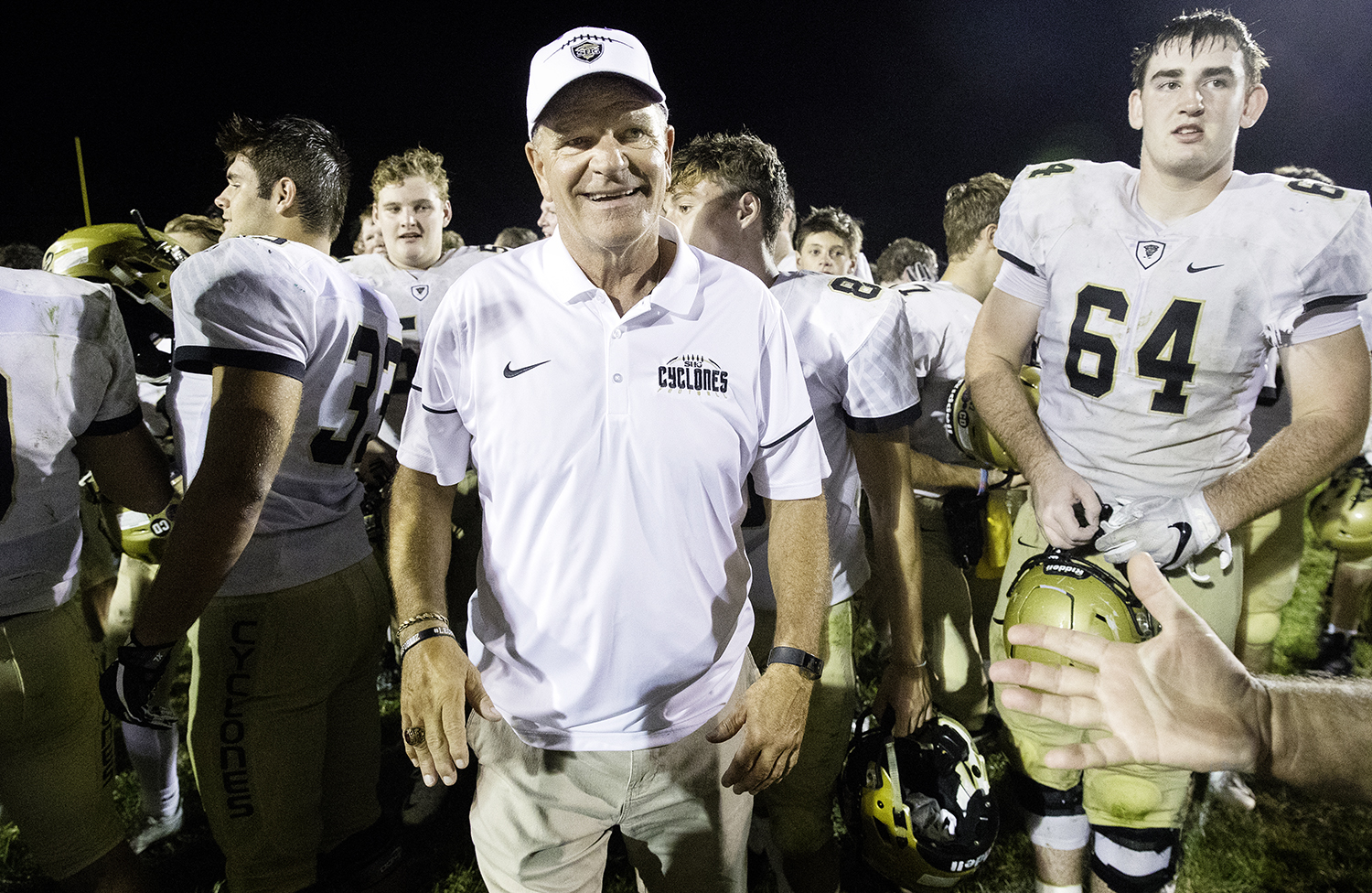 Sacred Heart-Griffin head coach Ken Leonard smiles as he receives congratulations after defeating Southeast and tying the all-time win record for an Illinois high school football coach Friday, Sept. 14, 2018. [Ted Schurter/The State Journal-Register]