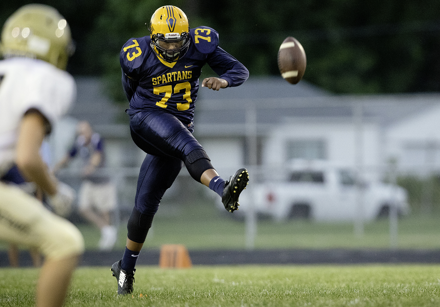 Southeast's Decorian Sexton kicks the ball away to Sacred Heart-Griffin at Southeast High School Friday, Sept. 14, 2018. [Ted Schurter/The State Journal-Register]