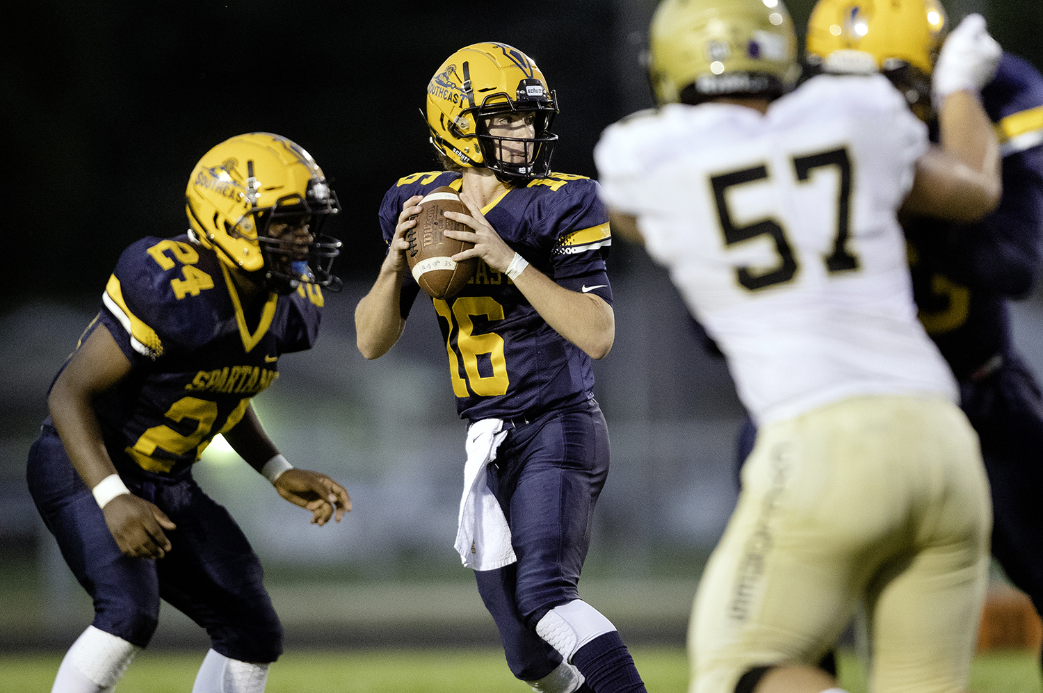 Southeast quarterback Stuart Ross drops back for a pass against Sacred Heart-Griffin at Southeast High School Friday, Sept. 14, 2018. [Ted Schurter/The State Journal-Register]