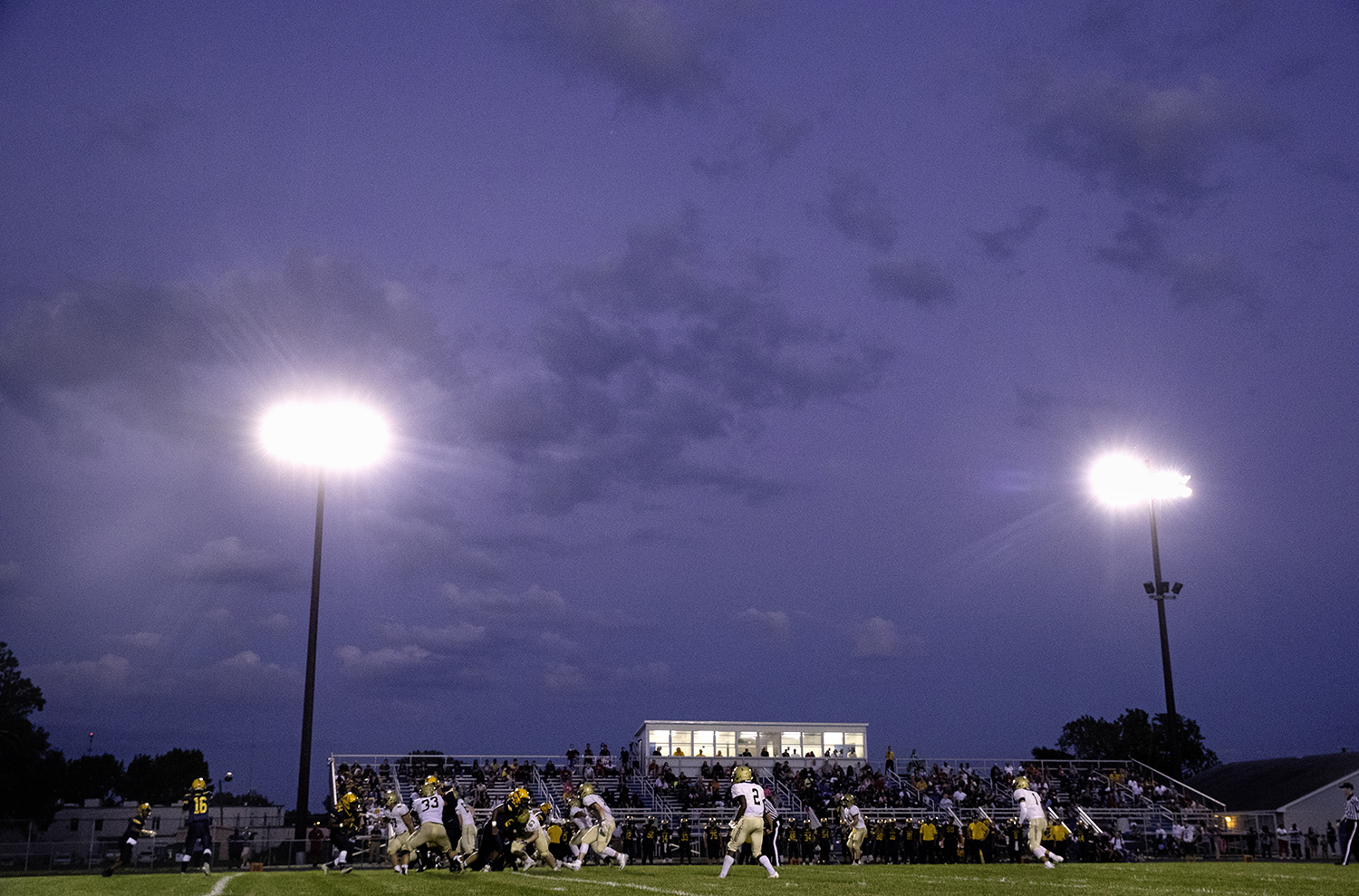 The Southeast Spartans take on the Sacred Heart-Griffin Cyclones as night falls at Southeast High School Friday, Sept. 14, 2018. [Ted Schurter/The State Journal-Register]
