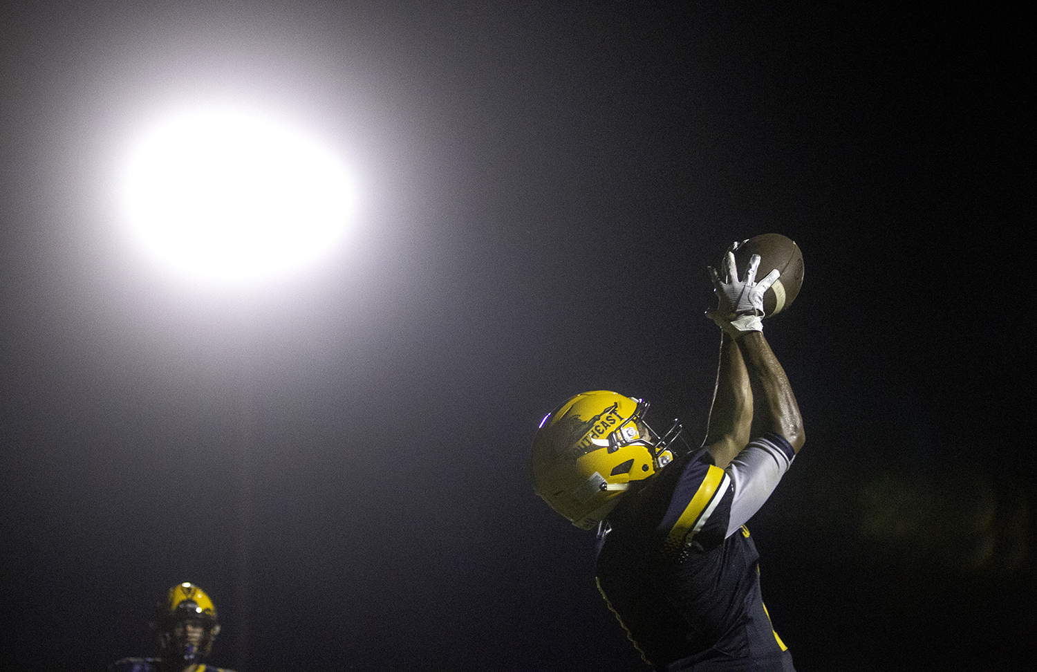 Southeast's Isaiah Cooper makes a catch for a two point conversion against Sacred Heart-Griffin at Southeast High School Friday, Sept. 14, 2018. [Ted Schurter/The State Journal-Register]