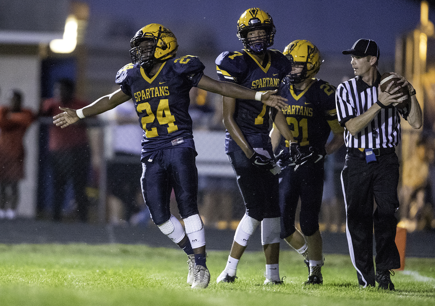 Southeast's Brian Kirkham celebrates a touchdown against Sacred Heart-Griffin at Southeast High School Friday, Sept. 14, 2018. [Ted Schurter/The State Journal-Register]