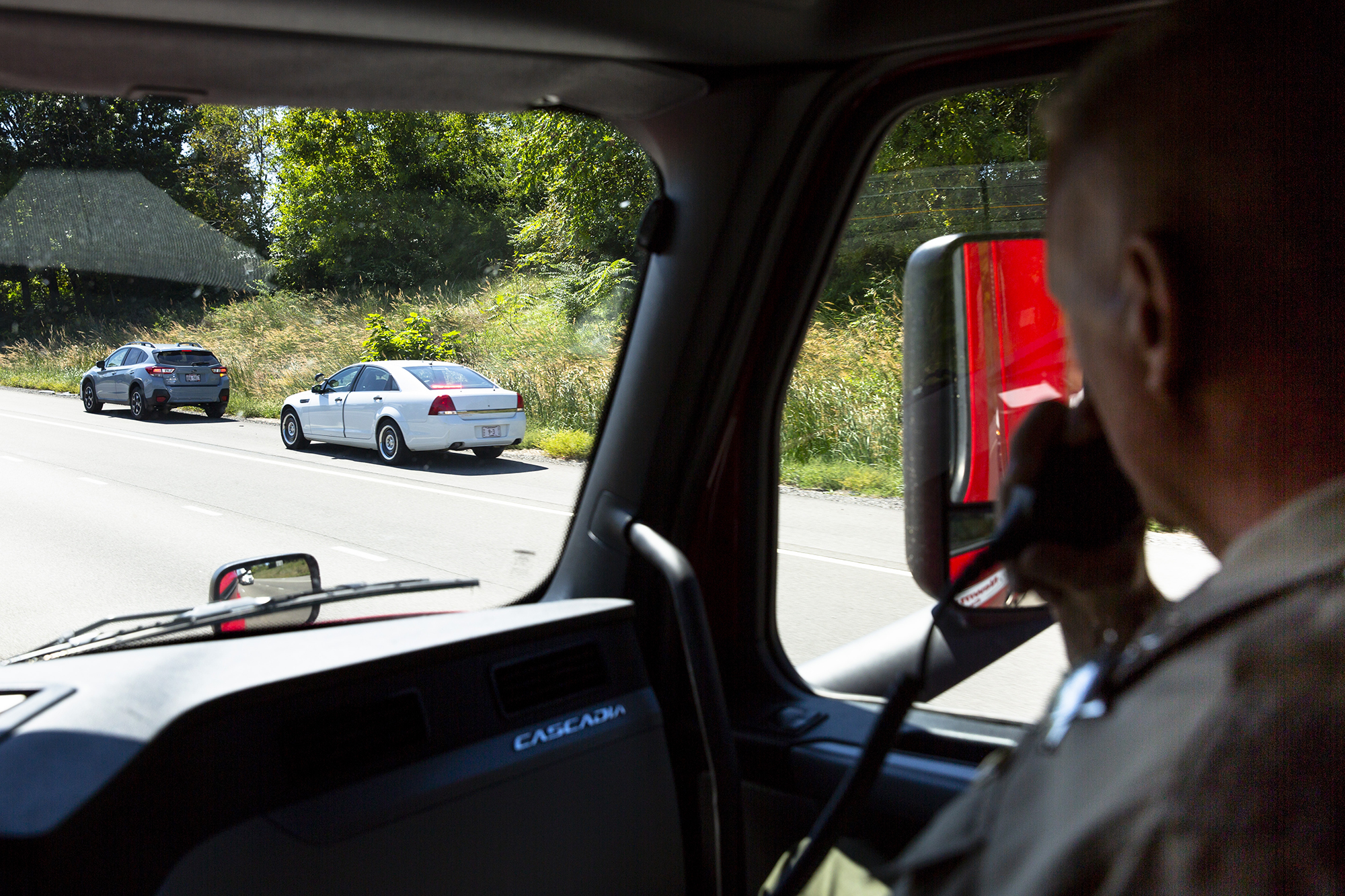 Illinois State Police Trooper Sean Ramsey, the safety education officer for District 9, watches as another trooper pulls over a vehicle they spotted with a driver texting on his cell phone Wednesday, Sept. 12, 2018 on Interstate 55 between Pawnee and Williamsville. The State Police conducted a four-hour Trooper-in-a-Truck detail on the interstate, patrolling from a tractor-trailer where they could more easily see drivers using their cell phones. The collaboration with the Illinois Trucking Association is meant to raise awareness of the dangers of distracted driving and resulted in 13 citations. The State Police have conducted two other patrols in Southern Illinois, this was the first in the Springfield area. [Rich Saal/The State Journal-Register]
