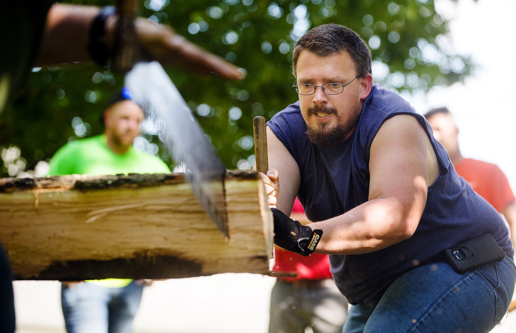 Jonathon Norin competes in a cross cut competition Abraham Lincoln National Railsplitting Festival at the Postville Courthouse in Lincoln Saturday, Sept. 15, 2018. [Ted Schurter/The State Journal-Register]