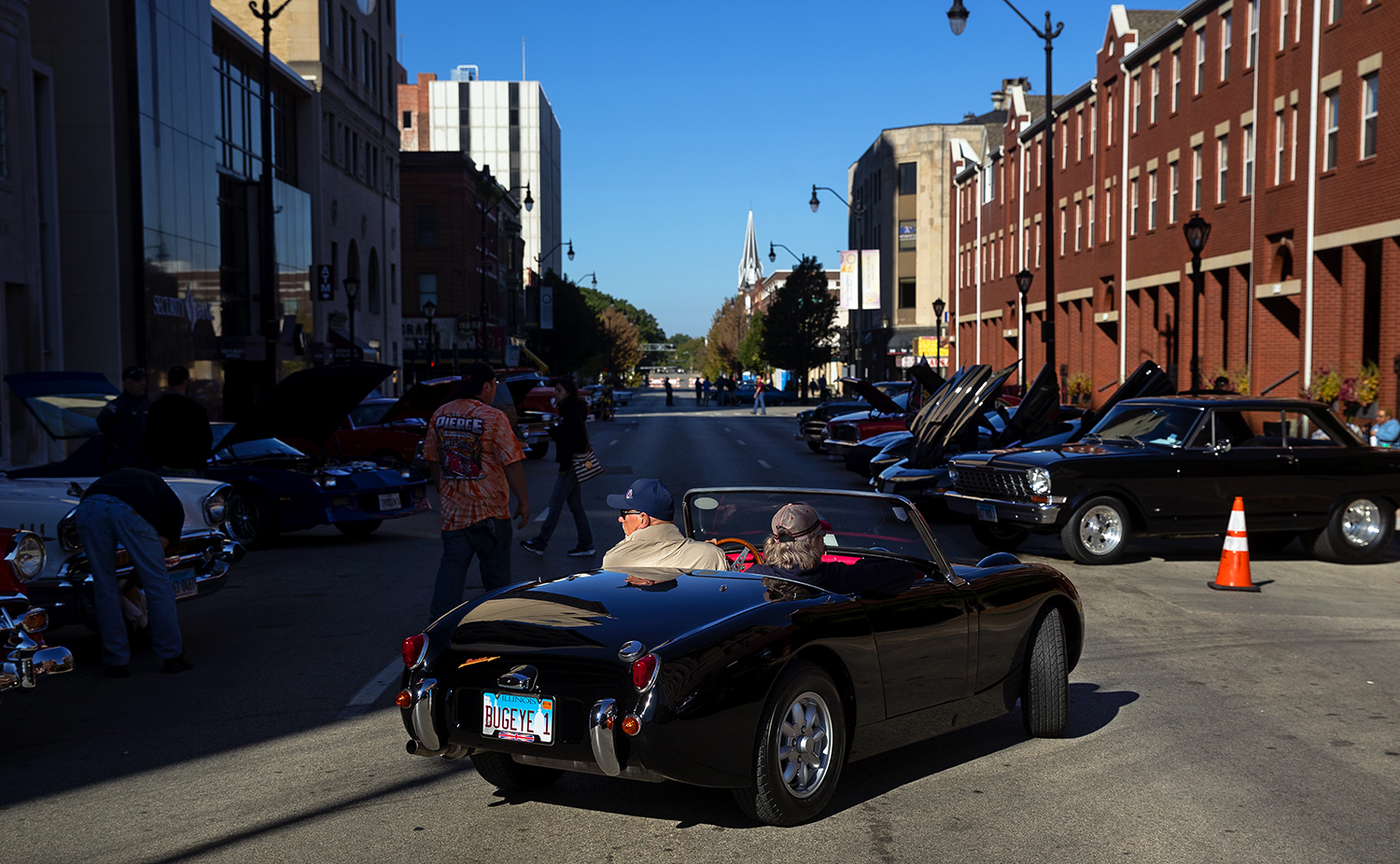 An MGA roadster backs into a space on Monroe Street during the 17th Annual International Route 66 Mother Road Festival Sunday, Sept. 23, 2018. [Ted Schurter/The State Journal-Register]