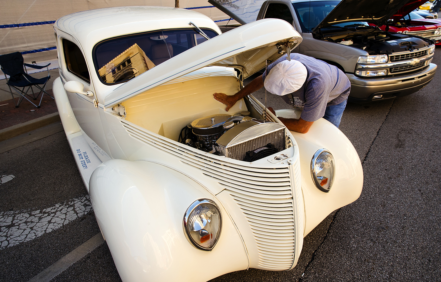 Don Fanning wipes down the engine bay of his 1938 Ford Humpback during the 17th Annual International Route 66 Mother Road Festival Sunday, Sept. 23, 2018. [Ted Schurter/The State Journal-Register]