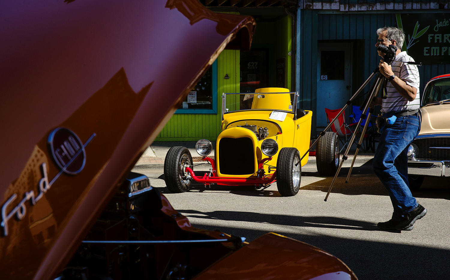 Louis Schrum's yellow 1928 Ford reflects the early morning light during the 17th Annual International Route 66 Mother Road Festival Sunday, Sept. 23, 2018. [Ted Schurter/The State Journal-Register]