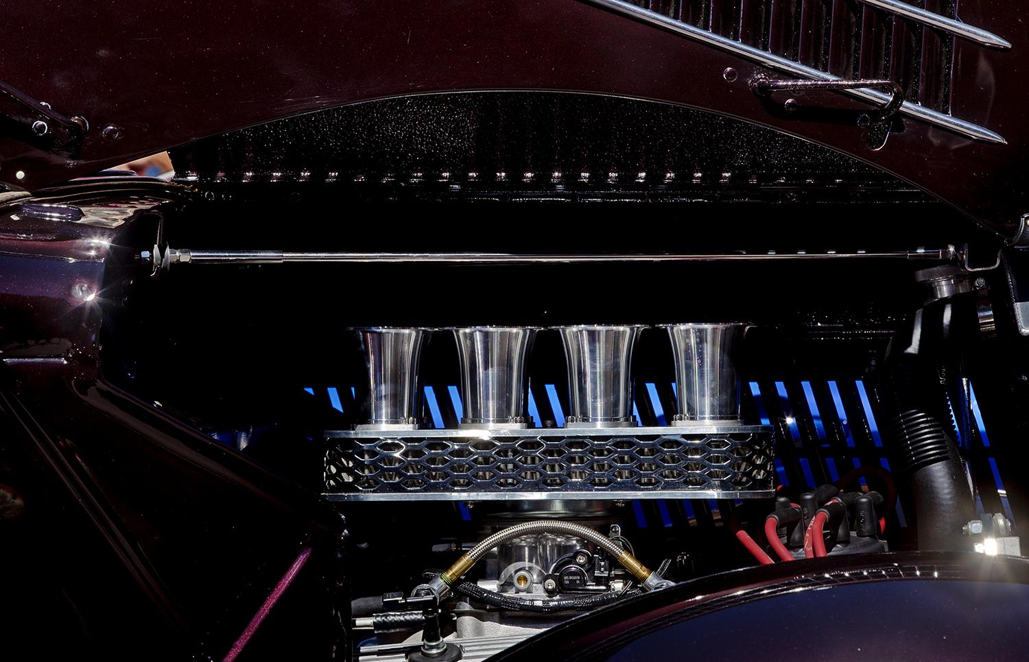 Four chrome velocity stacks top the intake on a 1936 Ford on display at the 17th Annual International Route 66 Mother Road Festival Sunday, Sept. 23, 2018. [Ted Schurter/The State Journal-Register]